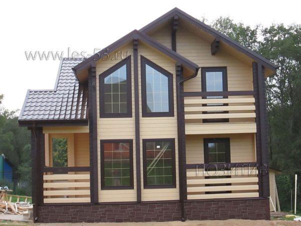 Фото двухэтажного дома из бруса К-31
