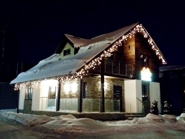 Освещение фасада каркасного дома Tirol