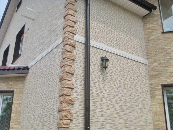 Фасадные панели под камень для каркасного дома