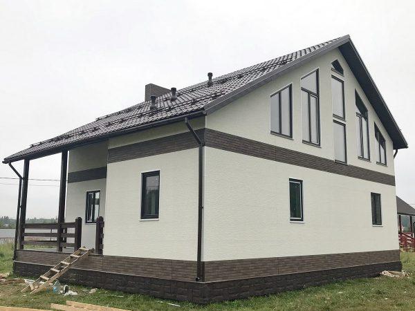 Каркасный дом с облицовкой японскими фибропанелями.